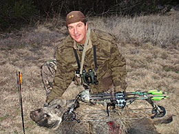 Jim Browning gets a big hog on the ranch in the spring of 2007.